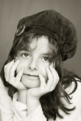 Black and white portrait beautiful girl with a cap