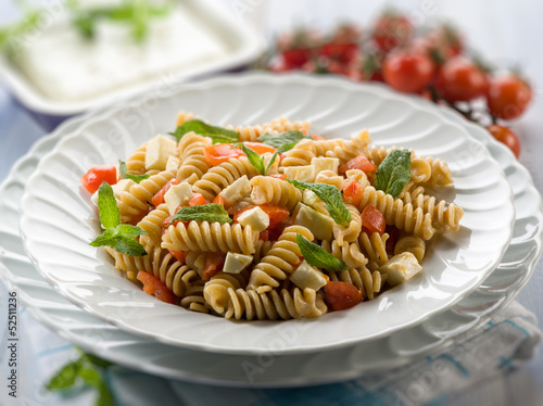 pasta with feta cheese fresh tomatoes and mint leaf, selective f