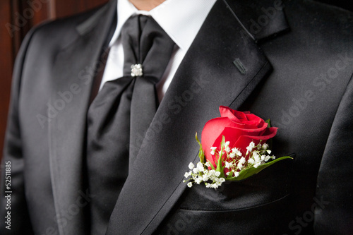 Groom in elegant black wedding dress