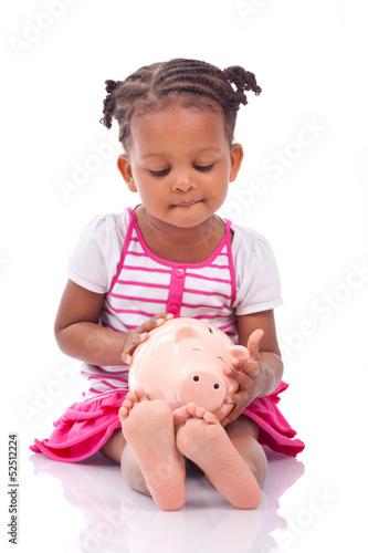 Cute little black girl holding a smiling piggy bank - African ch