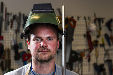 welder wearing helmet at work place