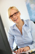 Portrait of smiling businesswoman with eyeglasses