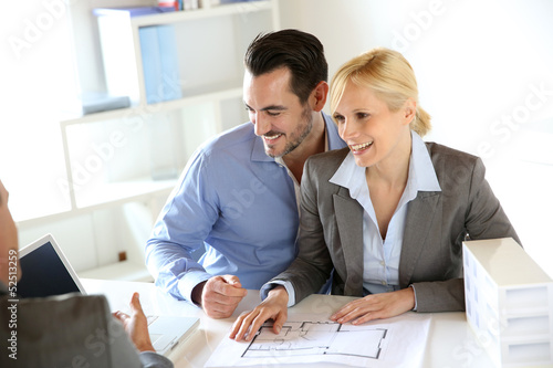 Couple meeting construction planner