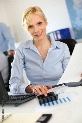 Businesswoman reading document at work
