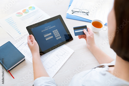 Businesswoman using a credit card for online internet banking
