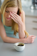 Portrait of young woman drinking coffee in the morning
