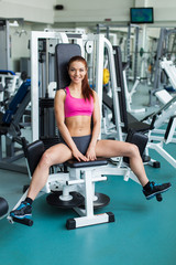 young fitness model works out on training apparatus