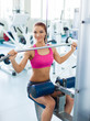 fitness model works out on in fitness center