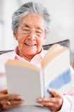 Beautiful old woman reading a book