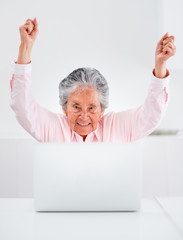 Elder woman with a laptop