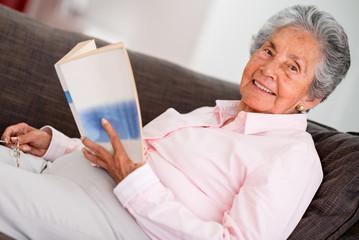 Edler woman reading a book