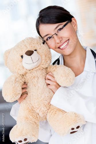 Friendly pediatrician smiling