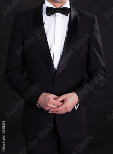 Stylish man in elegant black tuxedo