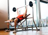 Fototapety Man lifting a yoke