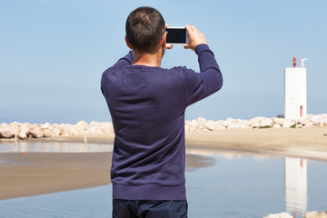 Man Photographing Lighthouse