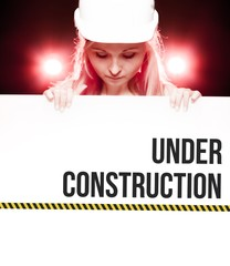 Under construction sign held by worker
