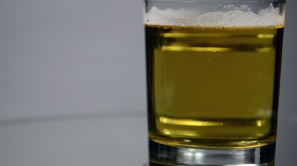 Vodka leaves from the glass with beer.