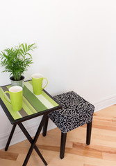 Little table with bright green cups