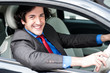 Young businessman driving his car