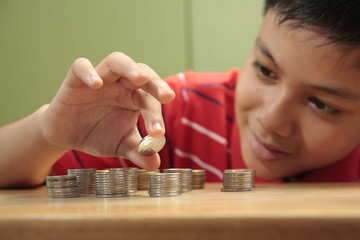 Boy and a Pile of Coins