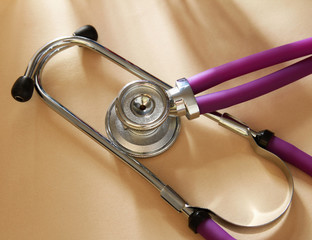 Doctor's stethoscope isolated on a wood background