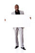 Happy successful businessman holding blank advertisement.