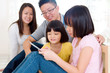 Asian family using tablet computer