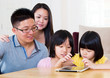 Asian kids using tablet computer