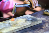 Goldsmith making ring poster