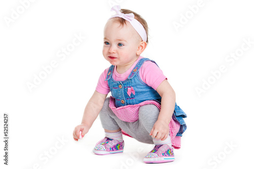 Baby in an pink dress . isolated on white background.