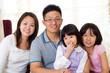 Indoor portrait of asian family