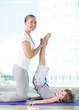 Healthy morning stretching - woman with son doing gymnastic exer