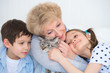 Portrait of smiling grandmother and grandchildren hugging