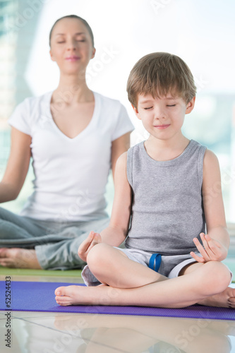 Mother and son doing yoga