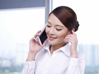 asian businesswoman talking on cellphone