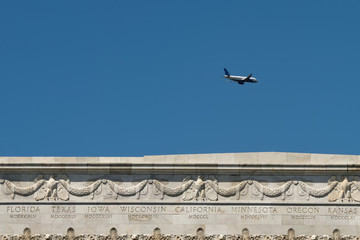 A plane on the Lincoln memorial States inscription