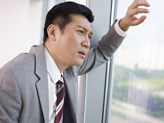 frustrated asian businessman