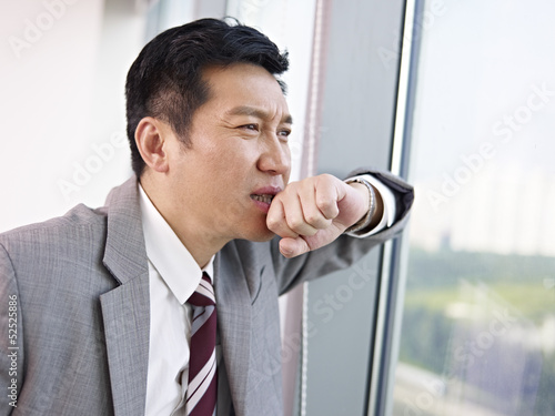 thinking asian businessman