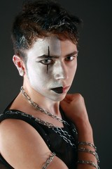 portrait of a young man with silver makeup