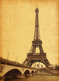 Eiffel tower view from Seine river.  Photo in retro style.