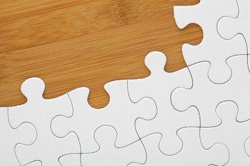 Puzzle on wooden board
