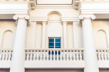 Detail of building with balcony and window.