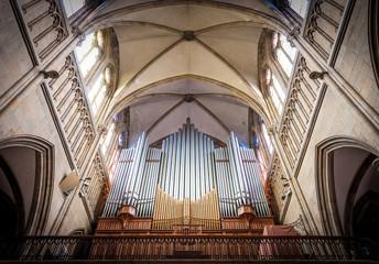 Great organ under arch in catholic church.