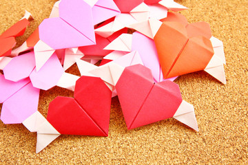 Origami colorful heart on corkboard