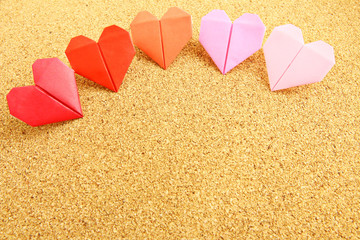 Origami colorful heart on corkboard