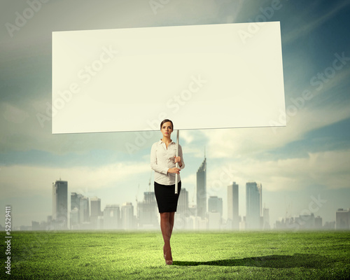 Woman holding blank board