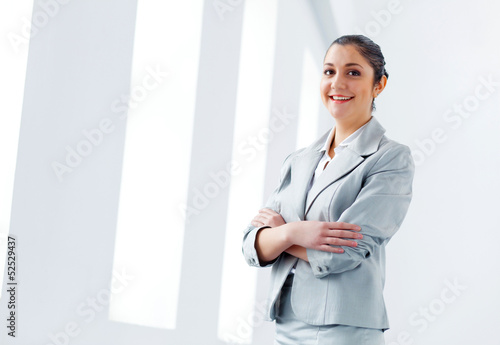 Attractive asian businesswoman in grey suit