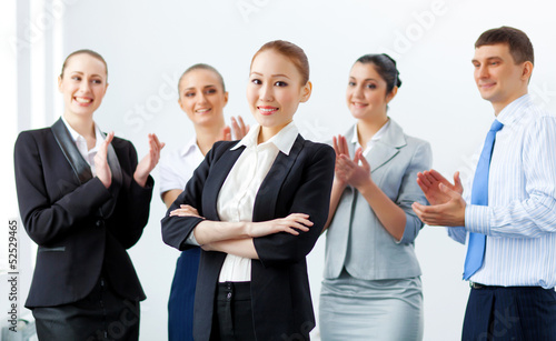 Asian business woman with colleagues