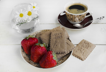 Coffee, cookies and strawberries