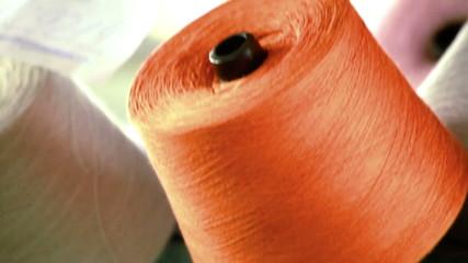 Orange and green spools of thread